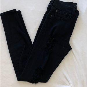 Black distressed denim jeans